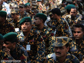Bangladeshi Rifles soldiers report back to base following the mutiny that left more than 70 dead.