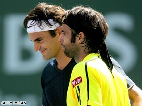 Federer (left) and Gonzalez embrace after their three-setter in California.