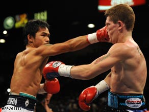 Pacquiao lands a solid right to Hatton on his way to a comprehensive victory.