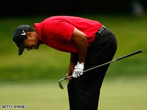 Woods is left frustrated again as a birdie attempt on the 12th narrowly misses.