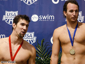 Michael Phelps stands on the podium with Aaron Peirsol after the men's 100m backstroke final Saturday.
