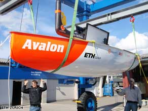 The autonomous yacht Avalon is hoisted to have her keel put in place before launching