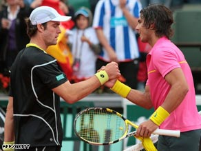 Perfect in pink. Nadal shakes hands with Gabashvili after his easy win.