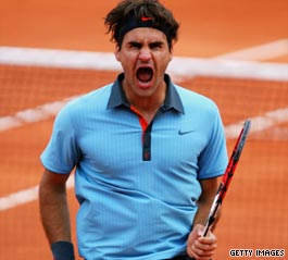 Roger Federer screams in joy after beating Juan Martin del Potro to reach the French Open final.