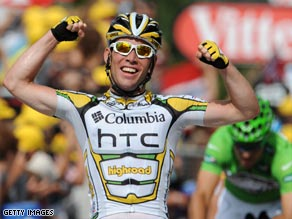 Cavendish celebrates his fourth stage win with Hushovd left trailing.