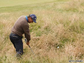 Padraig Harrington hits his second shot out of the rough on the third hole at Turnberry on Saturday.