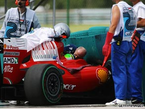 Felipe Massa receives attention after his high-speed crash in Hungarian Grand Prix qualifying.