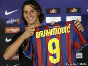 Ibrahimovic displays his new Barcleona shirt after completing his transfer from Inter Milan.