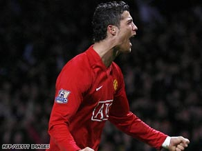Ronaldo celebrates his late free-kick as Manchester United edged closer to retaining the Premier League.