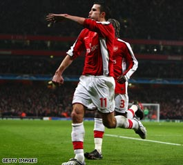 Van Persie celebrates the goal that gives Arsenal a slender Champions League lead going to Italy.