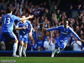 Michael Essien (right) celebrates his goal as Chelsea beat Manchester City to go second in the Premier League.