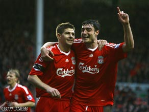 Gerrard (left) and Riera enjoyed superb afternoons at Anfield as Villa were routed.