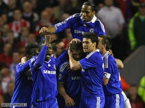 Chelsea players celebrate Branislav Ivanovic's equalizer on their way to a stunning win at Anfield.