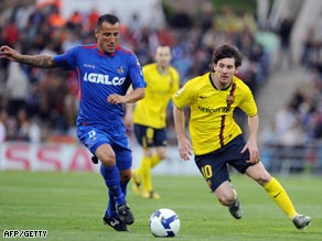 Messi (right) proved a handful for Getafe's defenders all night.