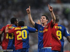 Messi celebrates his second and Barcelona's fifth in the Bernabeu.