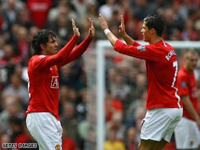 United goalscorers Tevez and Ronaldo celebrate the second goal at Old Trafford.