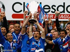 Rangers celebrate winning the Scottish title  after three seasons of Celtic dominance.
