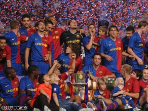 Barcelona players celebrate collecting the Primera Liga trophy despite their 1-0 home defeat by Osasuna.