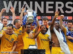 Chelsea's players celebrate after winning their only piece of silverware this season.