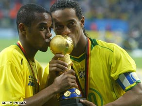 Robinho (left) and Ronaldinho (right) celebrate Brazil winning the Confederations Cup in 2005.
