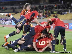 Fernando Torres (No.9) is congratulated after his opening goal in the 5-0 rout of New Zealand.