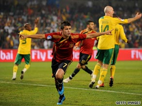 The South African players appeal for handball as David Villa celebrates Spain's opening goal on Saturday.
