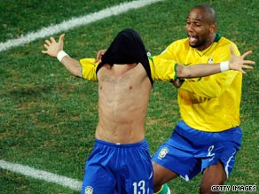 Daniel Alves is congratulated by team-mate Maicon after scoring the winner against South Africa.