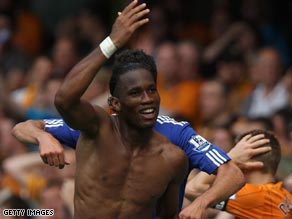 Drogba celebrates his dramatic late winner for Chelsea at Stamford Bridge.