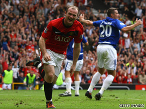 Wayne Rooney wheels away in celebration after breaking the deadlock against Birmingham.