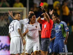 David Beckham (left) is shown a straight red card for his tackle on Seattle Sounders star Peter Vagenas.