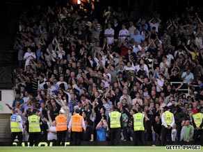 Millwall fans taunt West Ham supporters during their English League Cup tie.