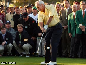 Arnold Palmer shows he has not lost any of his old magic as he strikes the first ball in the 73rd Masters.