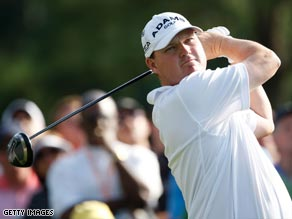 American Chad Campbell leads the Masters after day one with a seven-under-par 65.