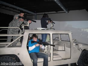Potential recruits play virtual-combat games at an Army recruiting center in Philadelphia, Pennsylvania.
