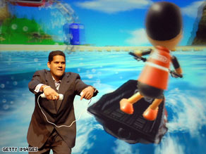 Nintendo of America President Reggie Fils-Aime demonstrates a Wii game at last year's E3 show.