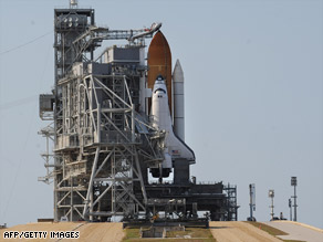 The space shuttle Atlantis is prepared for launch Sunday at the Kennedy Space Center in Florida.