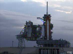 Space shuttle Endeavour is shown Sunday shortly after the day's launch was called off.