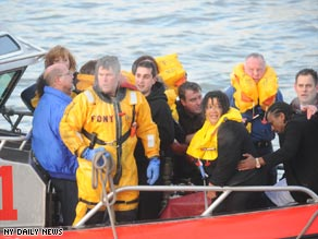 The New York Fire Department rescued passengers from the downed plane in the Hudson River.