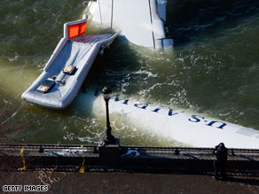 The disabled Airbus A320 is nearly submerged Friday as it is moored near New York's Battery Park City.