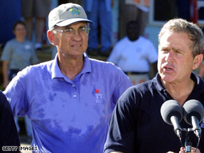 Millard Fuller appears with President Bush at a Habitat for Humanity event in Tampa, Florida, in 2001.