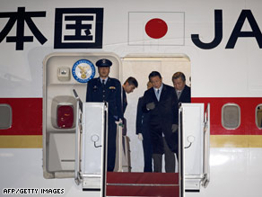 Japanese Prime Minister Taro Aso steps off his Boeing 747 at Andrews Air Force Base in Maryland Monday.