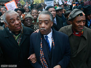 Rev. Al Sharpton, center, leads protests against the New York Post cartoon on February 19 in New York City.