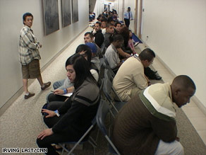 Applicants wait their turn for an interview at the Dodger Stadium job fair on Saturday.