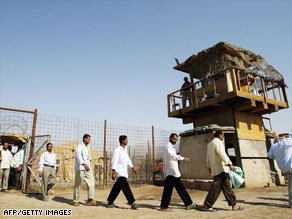 Detainees leave Baghdad Central Prison -- also known as Abu Ghraib -- in 2006.