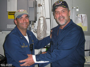 Phillips, right, stands with U.S. Navy Cmdr. Frank Castellano after Phillips' rescue Sunday.