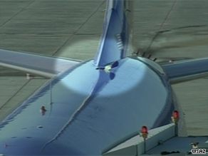 The breach in the aircraft's fuselage caused a loss of cabin pressure. No passengers were injured.