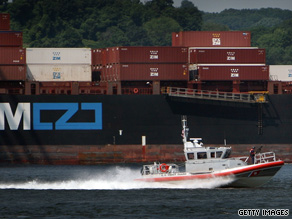 A U.S. Coast Guard vessel passes a container ship in New York Harbor as part of Tuesday's terror drill.