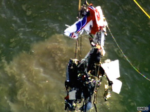 The wreckage of a PA-32 that collided Saturday with a helicopter is lifted Tuesday from the Hudson River.