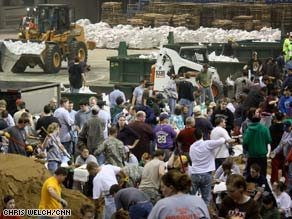 Up to 10,000 volunteers load sandbags at North Dakota State University on Tuesday.
