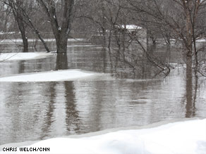 The water rises in Fargo, North Dakota, on Thursday, and the Red River could crest at 43 feet Saturday.